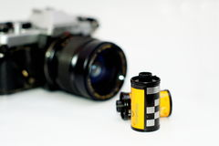 35mm Film rolls and film camera. Film rolls and film camera ,Selective focus stock photos