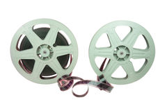 35mm Film In Two Reels. A 35mm film in two plastic reels, isolated over white background, with clipping path stock images