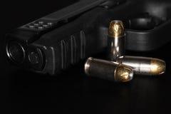 A 45 mm gun. A  45 mm gun and bullets Stock Photography