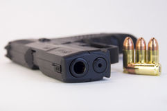 9mm gun bullets with a gun. Royalty Free Stock Photography
