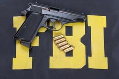 Fbi concept. 9mm handgun with ammo on fbi uniform Royalty Free Stock Photography