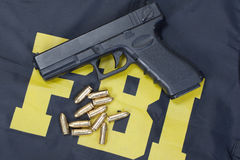 FBI. 9mm handgun with ammo on fbi uniform Stock Photography
