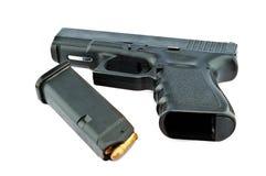 9-mm handgun and target shooting Stock Photography