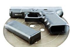 9-mm handgun and target shooting Stock Photo