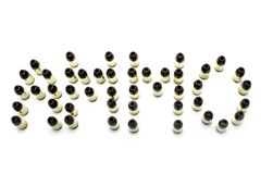 9mm hollowpoint bullets arranged to spell out ammo. 9mm hollowpoint bullets arranged to spell out the word ammo stock photography
