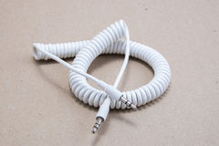 3.5 mm jack spiral cable. 3.5 mm male to male adapter cable Stock Photography
