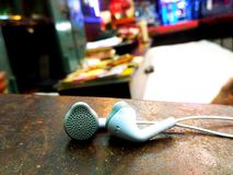 3.5 mm jack white earphone. royalty free stock photography