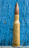 7 62mm Kugel und hölzerner Hintergrund Lizenzfreies Stockbild