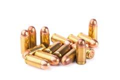 9mm kula för ett vapen på vit bakgrund Fotografering för Bildbyråer