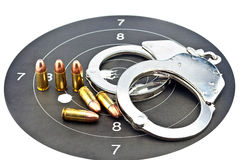 9mm Luger Ammunition and Handcuff Stock Photography