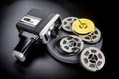8mm Movie Camera and Film. 8mm movie camera and reels of film Royalty Free Stock Image