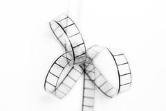 35mm movie film bow closeup, black and white on white background. 35mm movie filmstrip bow closeup, black and white on white background royalty free stock photos