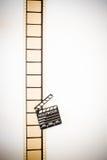 35mm movie filmstrip blank frames reel with clapper board. Vintage color effect vertical stock images