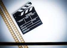 35mm movie filmstrip with clapper board, vintage color, horizont Stock Photos