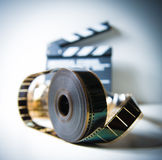 35mm movie reel with out of focus clapper in background stock images