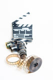 35mm movie reel with out of focus clapper in background Stock Image