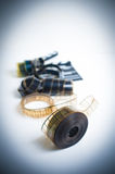 35mm movie reel with out of focus clapper in background, vertica. 35mm movie reel with out of focus clapper in background, color effect and vintage look royalty free stock photo