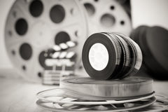 35 mm movie reels with clapper and boxes in background Royalty Free Stock Images