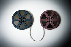 8mm movie reels connected with film in  color effect Royalty Free Stock Images