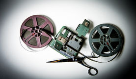 8mm movie reels, film on splicer ans scissors Royalty Free Stock Photos