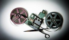 8mm movie reels, film on splicer ans scissors royalty free stock photos