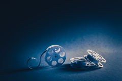 35mm movie reels made of paper with dramatic lighting stock image