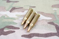 5.56mm NATO rounds. On camouflage background stock photo