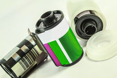 35 mm negative film - roll of camera film. A roll of Photographic film on a white background stock photography