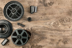 35 mm photo film and container for film development lying on wooden floor. Top view royalty free stock photo