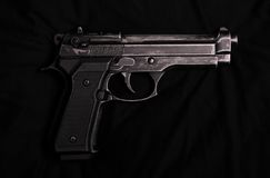 9mm pistol. On a black background Royalty Free Stock Photos