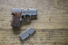 9MM Pistol. 9MM Handgun on a wooden table Royalty Free Stock Image
