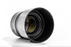 85mm Portrait lens angle white background. A 85mm Portrait lens angled with front element visible on a white background royalty free stock photography