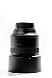 85mm Portrait lens. An 85mm Portrait lens sitting on the lens hood on a white background royalty free stock photography