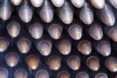 5.56 Bullets Stack. 5.56mm rifle cartridges piled up in an organized stack. View from the front Stock Photos