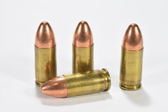 9mm rounds. Four rounds of 9mm pistol ammunition stock photography