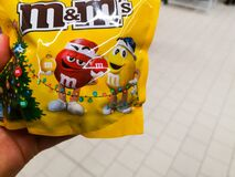 Mm`s multi-colored chocolate candies in yellow packaging for sale in Auchan shopping center on December 25, 2019 in Russia, Kazan