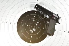 9 mm. semi automatic handgun and shooting target. Handgun and shooting target for practice Stock Photos