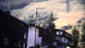 (8mm Vintage) 1966 Aspen Colorado Skiers Lodge Summer Mountain View. Original vintage 8mm home movie film professionally cleaned and captured in 4k (3840x2160 stock footage