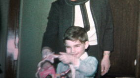 (8mm Vintage) 1965 Child With Easter Basket From Mom and Dad stock video footage