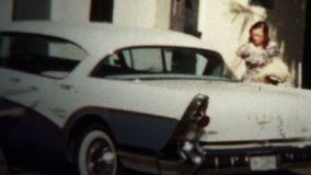(8mm Vintage) 1956 Children Excited Taking New Car To Church stock video