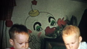 (8mm Vintage) Creep Clown Wallpaper Kids Playing 1957 stock video