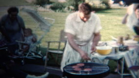 (8mm Vintage) 1954 Dad Making Hamburgers For Lunch. Iowa, USA.