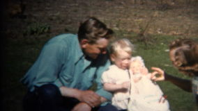 (8mm Vintage) 1952 Dad Mom & Baby Farm Picnic, Chickens In Background. Iowa, USA.
