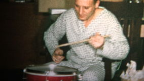 (8mm Vintage) 1965 Dad and Son Playing Drums Together Christmas Morning stock footage