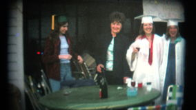 (8mm Vintage) High School Graduation Party stock footage