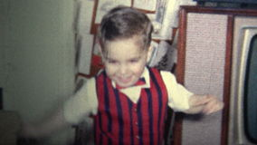 (8mm Vintage) 1965 Kid Dressed Up Like A Christmas Story Movie. stock footage