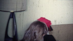 (8mm Vintage) 1965 Kid Gets Toy Bazooka Weapon For Christmas stock footage