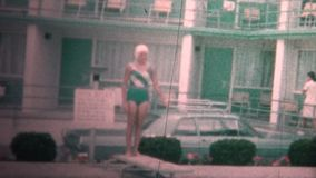 (8mm Vintage) 1966 Kids Diving Board At Motel Pool. Original vintage 8mm home movie film professionally cleaned and captured in 4k (3840x2160 UHD) resolution stock video footage