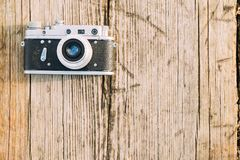35mm Vintage Old Retro Small-Format Rangefinder Camera On Old Wooden. Boards Desk Surface Royalty Free Stock Photo