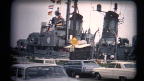 (8mm Vintage 1970s) Warship Tour Pan Old Classic Cars stock video footage